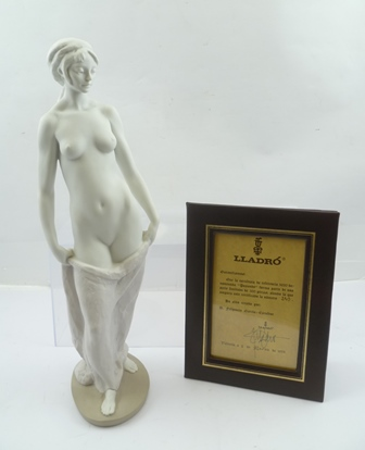 A LIMITED EDITION LLADRO FIGURINE Posando disrobing young woman, bisque porcelain after Fulgencio 39cm high with certificate framed