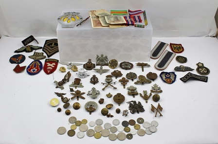 A COLLECTION OF BRITISH ARMY CAP BADGES, includes First World War Tank Corps, The Kings Own, The Welch, etc together with embroidered patch badges, an AA car badge, bank notes etc.