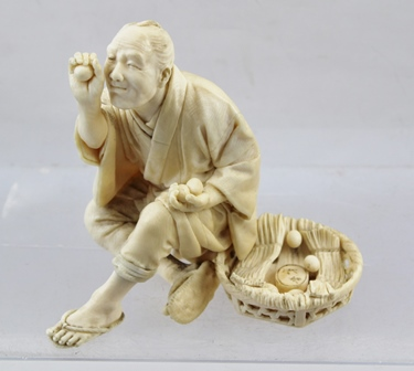 A JAPANESE MEIJI PERIOD IVORY CARVING depicts a seated man inspecting eggs, a basket at his side. 12cm high.