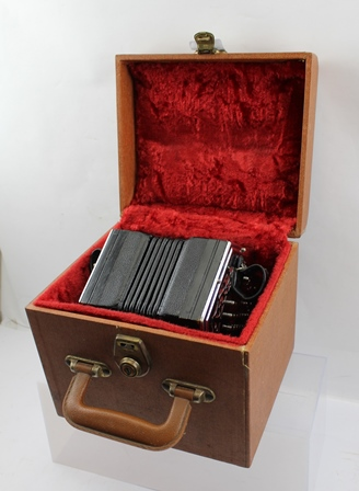 A WHEATSTONE OF LONDON CONCERTINA with hexagonal plated fret end plates, fitted 48 buttons, serial no.37044, in carrying case