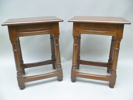 A MATCHED PAIR OF MID 20TH CENTURY CRAFTSMAN BUILT YEW WOOD JOINT STOOLS, having plain rectangular tops, on turned and block legs with aged stretchers between, each standing 58cm high x 44cm wide