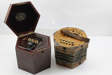 A LACHENAL CONCERTINA of rosewood hexagonal form with rosewood carrying case, bears label inside lid Lachenal & Co., London, together with ONE OTHER CONCERTINA