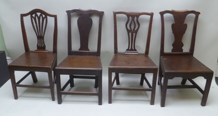 A HARLEQUIN COLLECTION OF EIGHT EARLY 19TH CENTURY SINGLE CHAIRS, country style, some with pierced and some with shaped splat backs, plank seats, on squared tapering supports with plain stretchers