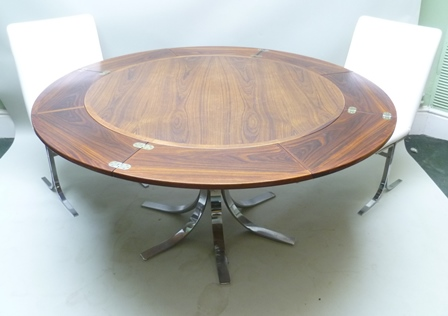 DYRLUND SMITH OF DENMARK A 1970s FLIP-FLAP DINING TABLE with expanding circular rosewood top, 110cm diameter closed, (with Article 10 Cites Certificate) supported on a chromed base, 74cm high, with SET OF SIX CHAIRS, white leatherette upholstered, on chromed frames 90cm