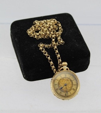 A CONTINENTAL 14K CASED LADYS FOB WATCH, decoratively chased, having gilded dial with Roman numerals, on a 9ct. gold CHAIN, weight of chain 16g.