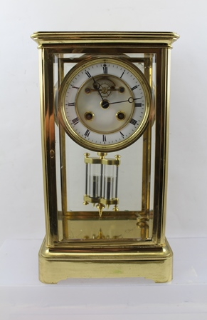 A LATE 19TH CENTURY FRENCH FOUR-GLASS CLOCK, the plain brass frame with bevel cut glass, the white enamel dial with Roman numerals displays a Brocot escapement, with 8-day striking movement, fitted with a mercury compensatory pendulum, case 30cm high