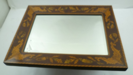 A LATE 19TH CENTURY PROBABLY EUROPEAN FANCY INLAID MIRROR FRAME with scrolling flower husks and winged insects with chequer board stringing and central bevelled rectangular mirror plate, 35cm x 47cm overall