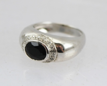 AN 18CT WHITE GOLD JET AND DIAMOND RING, various hallmarks, size O 1/2