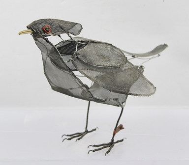 RACHEL HIGGINS (1970-) Blackbird; sculpture constructed from wire and metal mesh, fitted with stamped RH signature copper leg tag, 18cm high