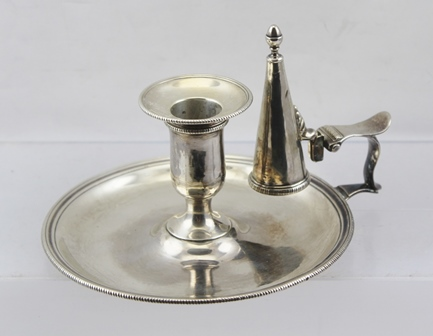 ROBERT JONES A GEORGE III SILVER CHAMBER STICK having beaded rim decoration, the snuffer with acorn finial, has similar border but the hallmarks are worn on this, clear marks on base of chamber stick, London 1777, 270g.