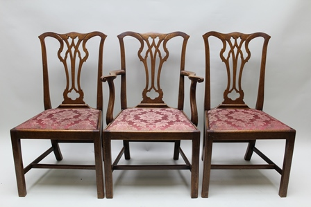 A SET OF SIX 19TH CENTURY CHIPPENDALE DESIGN MAHOGANY DINING CHAIRS comprising; four singles and a pair of open arm carvers, each having crown top rail over pierced splat, upholstered drop-in seat, on squared supports with plain stretchers