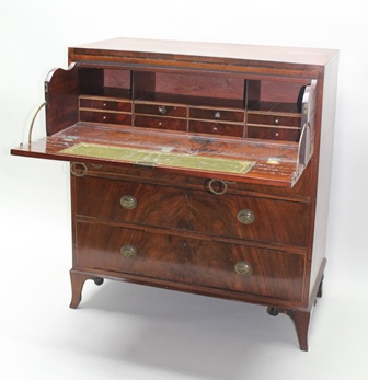 A 19TH CENTURY MAHOGANY SECRETAIRE CHEST, the top double faux front drawer drops to reveal a leather writing surface with drawers and pigeon holes, over three drawers below with cast brass urn back plate handles, on outswept bracket feet, 101cm wide