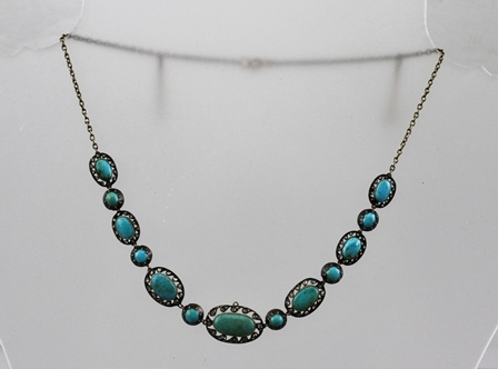 A LATE VICTORIAN TURQUOISE AND DIAMOND SET NECKLACE of linked, mounted design graduated polished stones, in original vendors box