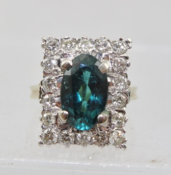 AN 18CT GOLD TOURMALINE AND DIAMOND CLUSTER RING stamped .750 ring size  M .5