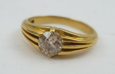 AN 18CT GOLD RING, set with a brilliant cut solitaire diamond