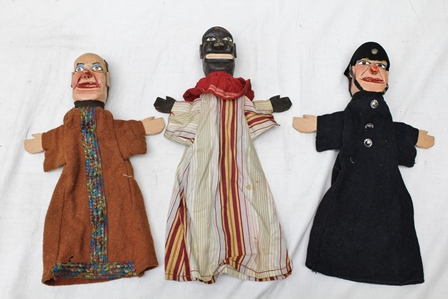 A COLLECTION OF SEVEN EARLY 20TH CENTURY HAND CARVED PUNCH AND JUDY PUPPETS