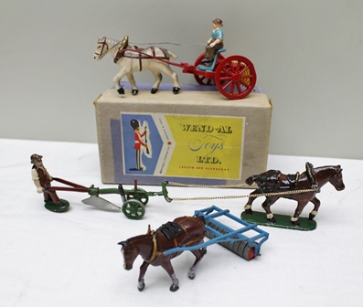 WEND-AL TOYS LIMITED DIE-CAST MODEL OF HORSEDRAWN HAYRAKE with attendant figure in OVB together with a Britains die-cast Farm Roller with shire horse and another model of a shire horse with single fullow plough and farmer attendant (3)
