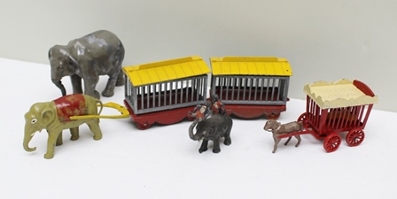 CHARBENS DIE-CAST TOYTOWN CIRCUS MODELS including elephant drawn pair of animal trailers, horse drawn animal trailer, large bull elephant and another elephant with circus performer