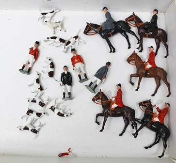 A BRITAINS CAST METAL HUNTING SET, five huntsman and their horses, four field attendants and ten hounds