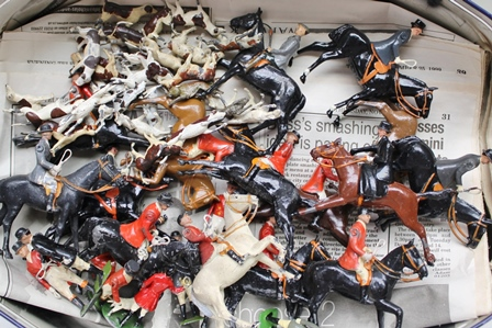 A QUANTITY OF CAST PAINTED LEAD FOXHUNTING SET comprising huntsman in pink jackets, horses, ladies sidesaddle, groom, mounted figures, hounds and prey