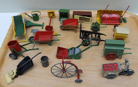 A QUANTITY OF PAINTED MINIATURE CAST METAL GARDEN ITEMS, includes, push mower, deck chair, water bowser, wheelbarrows, garden roller, watering can, street organ, hoover, penn farthing cycle, etc.