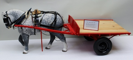 A & E STARLEY OF COVENTRY, WARWICKSHIRE A MODEL OF A FARM, FLAT TOP CART, red frame, plank bed, pneumatic tyres, with draught horse modelled on the Percheron, dimensions of cart bed, 54cm x 46cm (believed to be one-quarter scale)