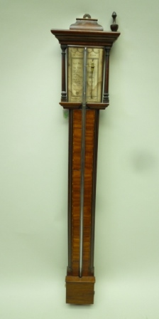 J. CORTI OF LONDON A 19TH CENTURY MAHOGANY CASED STICK BAROMETER, the caddy top with turned columns framing the engraved paper calibration gauge, 94cm high