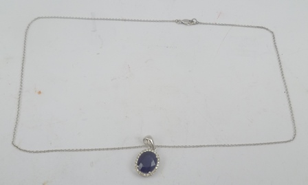 A SAPPHIRE AND DIAMOND PENDANT, mounted in 14k white gold, chain unmarked, possibly white gold