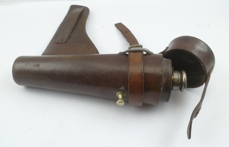 AN EARLY 20TH CENTURY JAMES DIXON & SONS HUNTING FLASK with plated mount, in a leather saddle holster