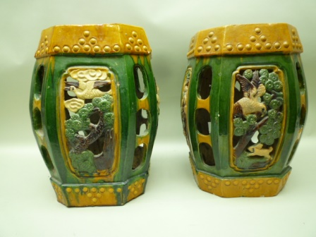 A PAIR OF FIRST HALF 20TH CENTURY CHINESE POTTERY GARDEN SEATS, of canted square barrel form, Sancai glazed with pierced decorative panels, 46cm high