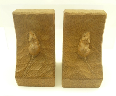 ROBERT MOUSEMAN THOMPSON A PAIR OF OAK BOOKENDS, each carved with a single signature mouse, 15cm high