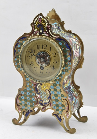 A CONTINENTAL ROCOCO DESIGN CHAMPLEVE ENAMEL DRAWING ROOM MANTEL TIMEPIECE, the gilded dial with Arabic numerals, circa 1910, 19cm high