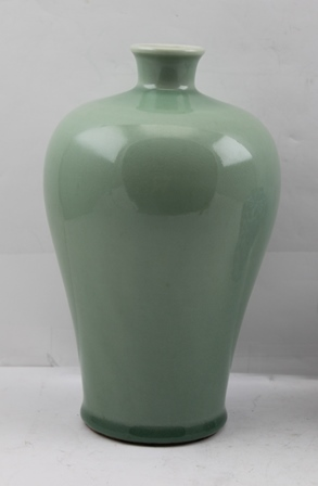 A CHINESE CHING DYNASTY CELADON GREEN GLAZED BALUSTER VASE, 24cm high