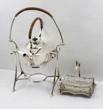 A SILVER PLATED SPIRIT KETTLE ON STAND, having woven wicker handle, together with an EPNS BONBON DISH with cut glass liner