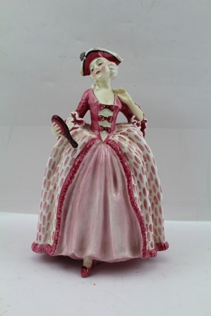 A ROYAL DOULTON CHINA FIGURINE, Camille HN1736 dressed in pink 18th century costume holding a vanity mirror, 18cm high
