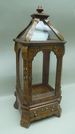 A 19TH CENTURY DUTCH MARQUETRY TABLE TOP DISPLAY CABINET, overall floral decoration in specimen timbers and mother-of-pearl, the glazed top with turned finial, glazed in the round with single door, on bombe form base with fitted drawer, on shaped feet, 85cm high