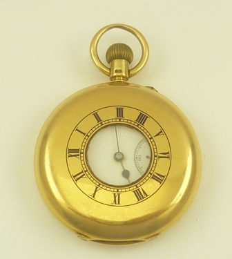 AN 18CT GOLD CASED HALF HUNTER GENTLEMANS POCKET WATCH, white enamel dial with Roman numerals and secondary dial, the front inset with blue enamel Roman numerals about a central lenticel, fitted ring suspension, back plate with engraved monogram