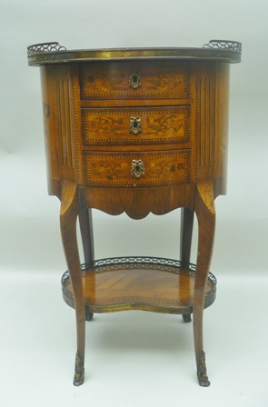 A 19TH CENTURY FRENCH SPECIMEN TIMBER MARQUETRY INLAID SALON TABLE, the oval top with brass partial gallery, inlaid with trophies, surrounded by flowers beneath a canopy carcase inlaid in the round, over three drawers, cabriole legs, united by a kidney shape undertier, inlaid with an ink well, quill and paper, also with a partial gallery, cast gilt metal feet and escutcheons, to top of gallery 80.5cm, width of top 49cm x 36cm