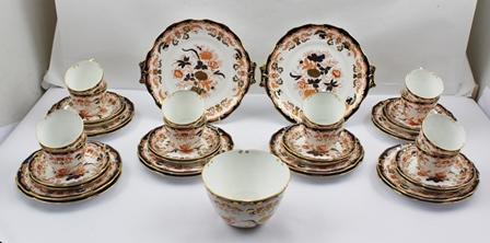 A ROYAL CROWN DERBY TEA SET in the Imari pattern no. 6685, comprising twelve cups, twelve saucers, twelve tea plates, two serving plates and a sugar bowl