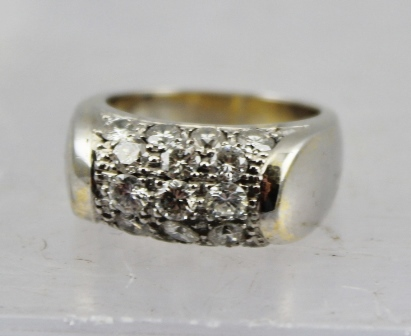 AN 18CT WHITE GOLD RING set with five rows of diamonds (17 stones), size K