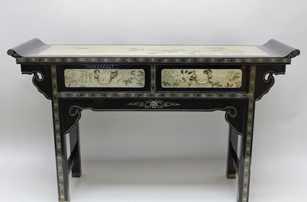 A 20TH CENTURY CHINESE ALTAR DESIGN SIDE TABLE, having two fitted drawers, black lacquer with gilded bird and blossom panels, raised on squared supports with stretchers, 134cm wide
