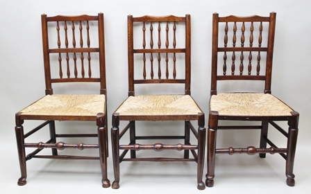 A SET OF SIX NORTH OF ENGLAND CHAIRS, each having double row spindle back, later rush seat, plain turned tapering forelegs terminating in pad feet, 96cm high
