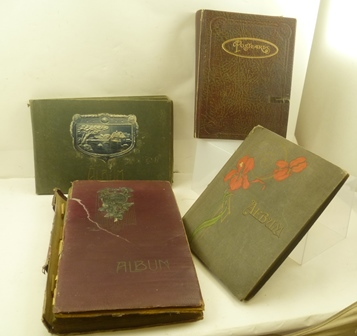 FOUR VINTAGE POSTCARD ALBUMS CONTAINING OVER  SEVEN HUNDRED EARLY POSTCARDS; subjects - greetings, travel, humour, hunting, military etc.