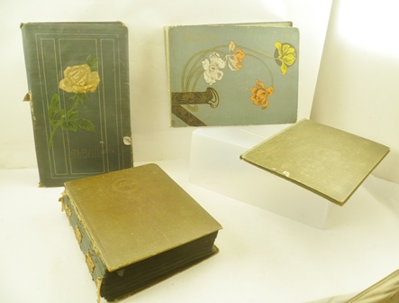 FOUR VINTAGE POSTCARD ALBUMS CONTAINING OVER  SEVEN HUNDRED VARIOUS EARLY POSTCARDS, subjects include - greetings, travel, royalty, hunting etc.