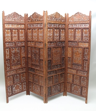 A 20TH CENTURY PROBABLY INDIAN CARVED HARDWOOD FOUR-PANELLED FOLDING SCREEN, comprising pierced foliate panels, approximately 6 high