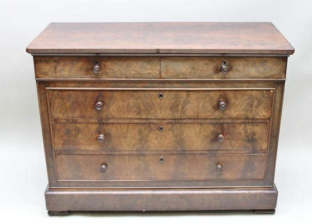 A 19TH CENTURY MAHOGANY CHEST OF DRAWERS fitted two short over three long drawers with turned knob handles, plus slender concealed drawer below within plinth base, 129cm wide, 56cm deep, 99cm high