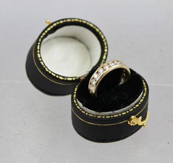 A 14K GOLD HALF ETERNITY RING set with twelve diamonds, ring size H and half