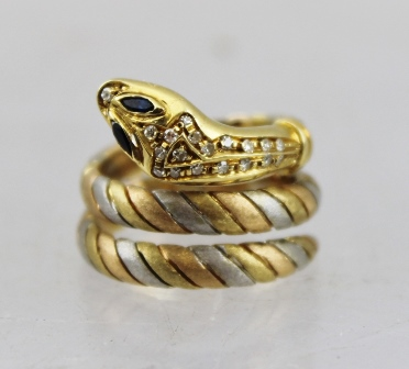 AN 18CT MULTICOLOUR GOLD SNAKE SCARF RING set with diamonds, with sapphire eyes, indistinctly marked