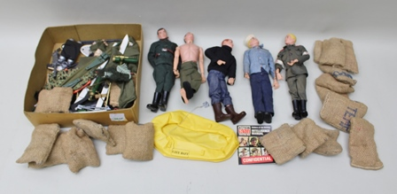FIVE ACTION MAN FIGURES together with a quantity of hessian sack bags, life raft, weapons and accessories