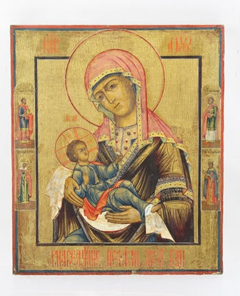 A 20TH CENTURY RUSSIAN ICON MADONNA AND CHILD, oil paint and gilded,  on a pine panel with border of Saints and Cyrillic script, inscription verso, 31cm x 26cm